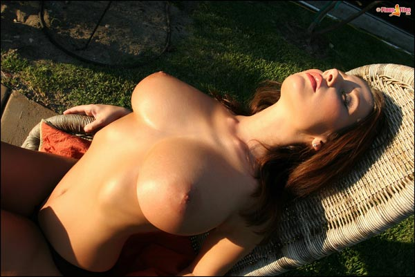 Busty Erica Campbell posing naked outdoors PinupFiles.com