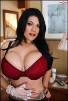 Sexy Anarica with big sweet boobs on her bed PinupFiles.com