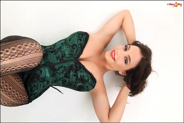Hot Desiree in black stockings shows her curves PinupFiles.com