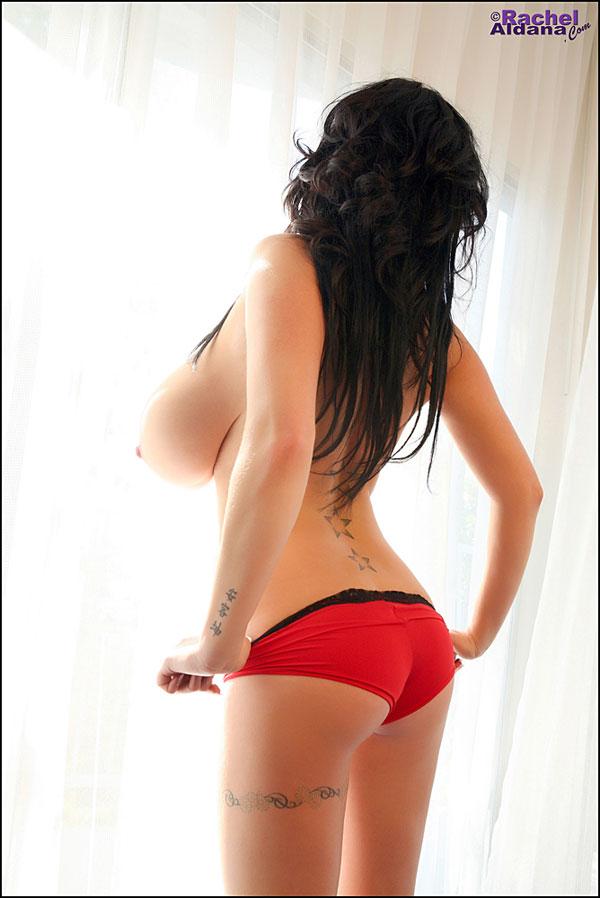 Rachel Aldana posing in sexy red short pants RachelAldana.com