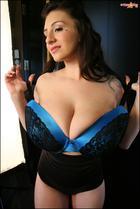 September Carrino rubbing her big natural boobs